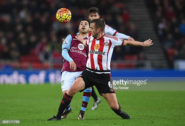 Lee Cattermole of Sunderland and Carles Gil of Aston Villa compete for the ball during the Barclays Premier League match between Sunderland and Aston...