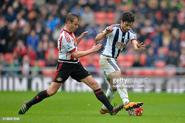 Lee Cattermole of Sunderland and Claudio Yacob of West Bromwich Albion battle for the ball during the Barclays Premier League match between...