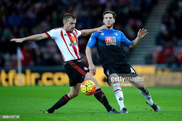 Lee Cattermole of Sunderland and Dan Gosling of Bournemouth compete for the ball during the Barclays Premier League match between Sunderland and AFC...