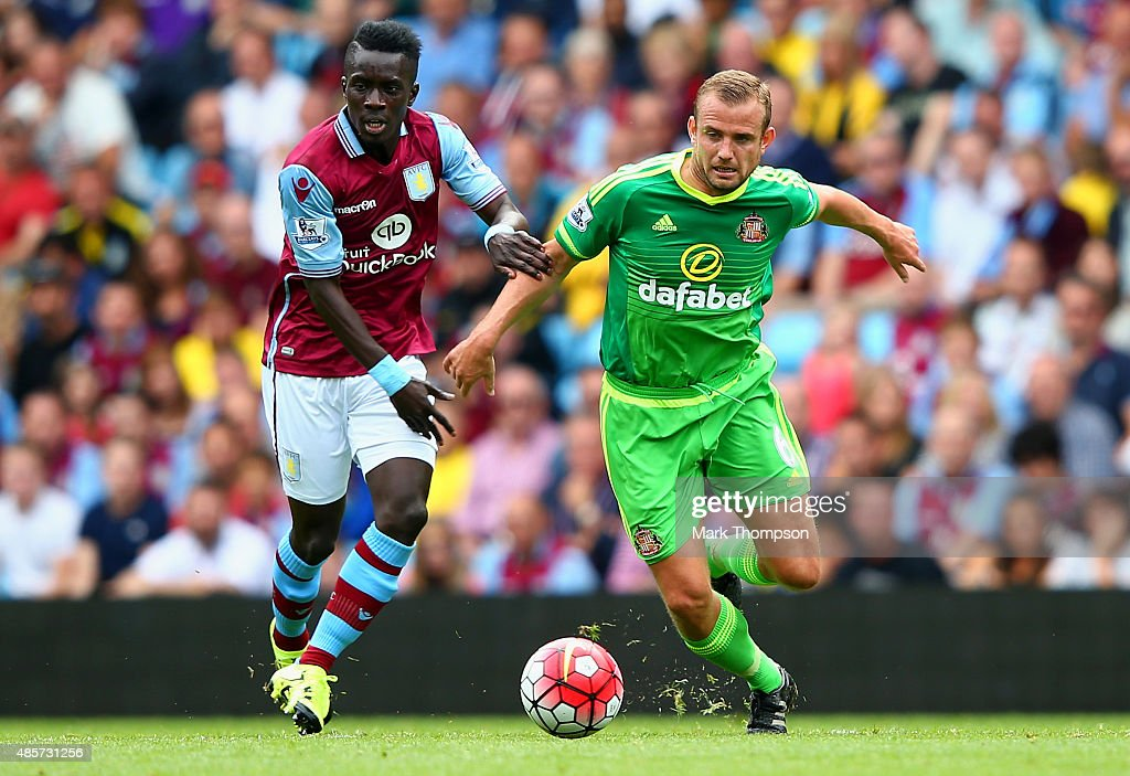 Lee Cattermole of Sunderland and Idrissa Gueye of Aston Villa compete for the ball during the Barclays Premier League match between Aston Villa and Sunderland at Villa Park on August 29, 2015 in Birmingham, England.