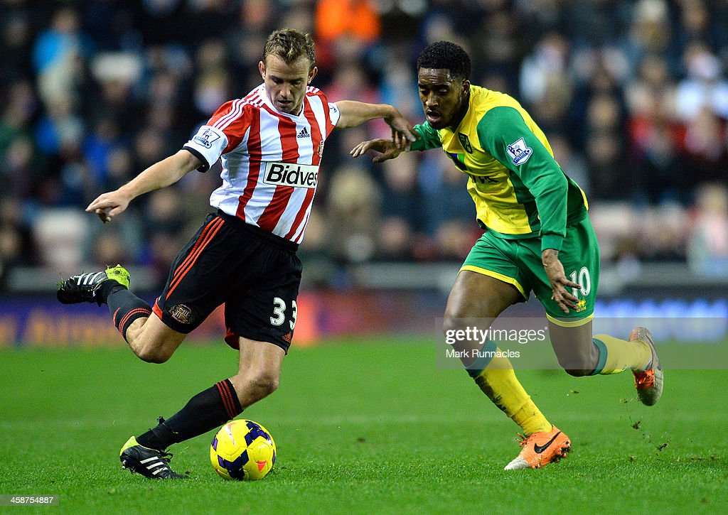 <a gi-track='captionPersonalityLinkClicked' href=/galleries/search?phrase=Lee+Cattermole&family=editorial&specificpeople=646988 ng-click='$event.stopPropagation()'>Lee Cattermole</a> of Sunderland and Leroy Feer of Norwich City in action during the Barclays Premier League match between Sunderland and Norwich City at the Stadium of Light on December 21, 2013 in Sunderland, England.