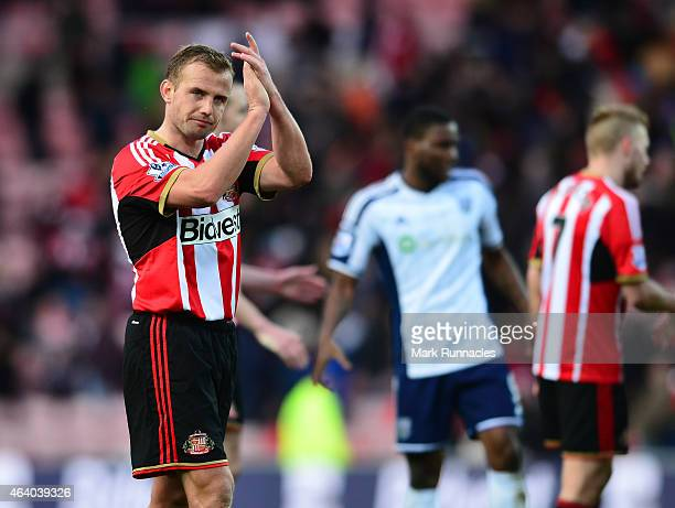 Lee Cattermole of Sunderland applauds the Sunderland fans at the end of the Barclays Premier League match between Sunderland and West Bromwich Albion...