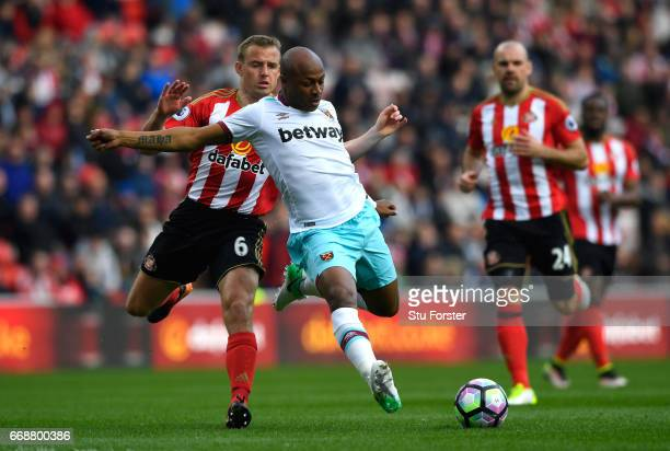 Lee Cattermole of Sunderland fouls Andre Ayew of West Ham United during the Premier League match between Sunderland and West Ham United at Stadium of...