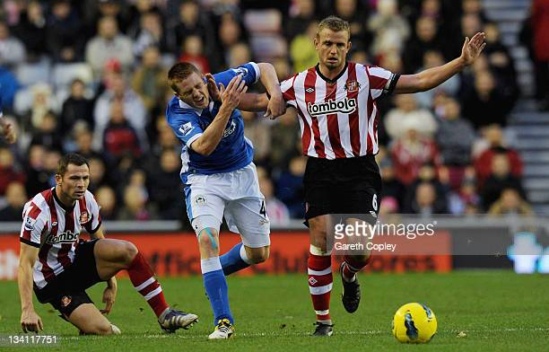 Lee Cattermole of Sunderland hands off James McCarthy of Wigan during the Barclays Premier League match between Sunderland and Wigan Athletic at...