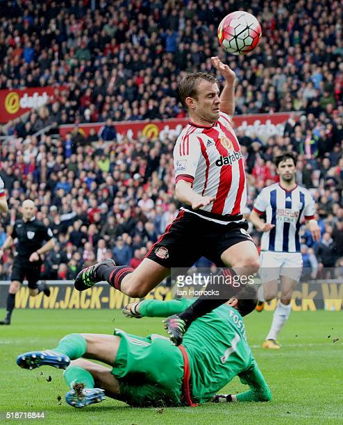 Lee Cattermole of Sunderland has his shot saved by West Bromwich keeper Ben Foster during the Barclays Premier League match between Sunderland and...