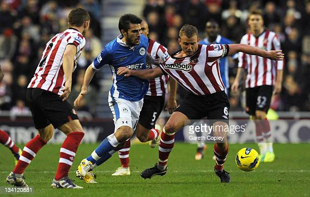 Lee Cattermole of Sunderland is tackled by Jordi Gomez of Wigan during the Barclays Premier League match between Sunderland and Wigan Athletic at...