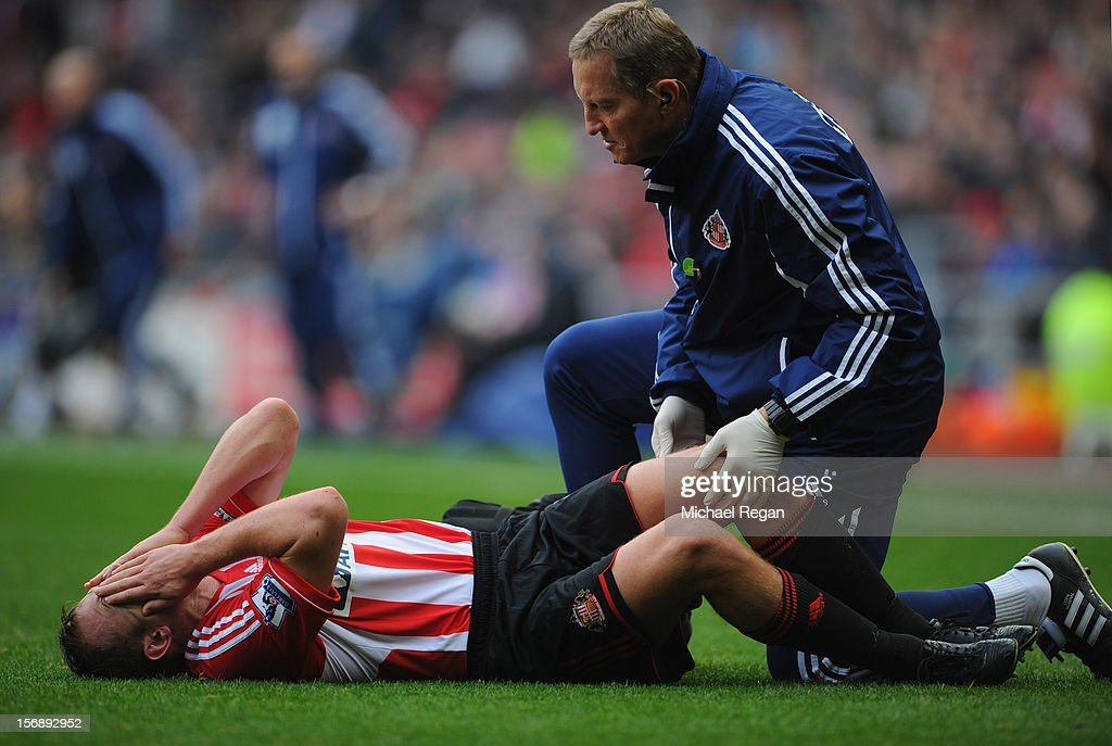 <a gi-track='captionPersonalityLinkClicked' href=/galleries/search?phrase=Lee+Cattermole&family=editorial&specificpeople=646988 ng-click='$event.stopPropagation()'>Lee Cattermole</a> of Sunderland lays injured during the Barclays Premier League match between Sunderland and West Bromwich Albion at the Stadium of Light on November 24, 2012 in Sunderland, England.