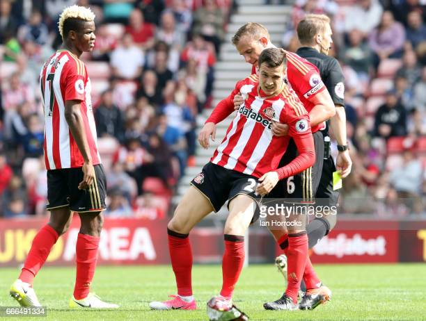 Lee Cattermole of Sunderland picks up Javier Manquillo during the Premier League match between Sunderland and Manchester United at Stadium of Light...