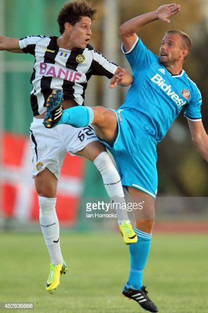 Lee Cattermole of Sunderland rises with Rondon of CD National during a preseason friendly match between CD National and Sunderland at the Estadio...