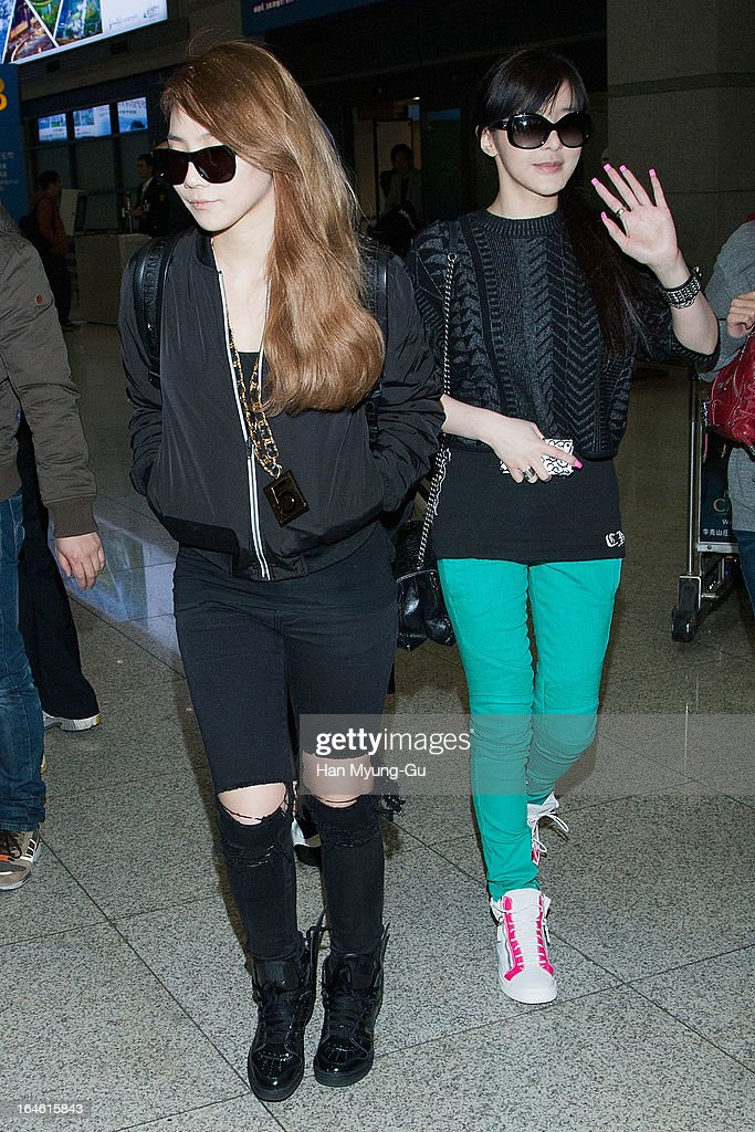Lee Chae-Rin (CL) and Park Bom (Bom) of South Korean girl group 2NE1 are seen upon arrival at Incheon International Airport on March 25, 2013 in Incheon, South Korea.