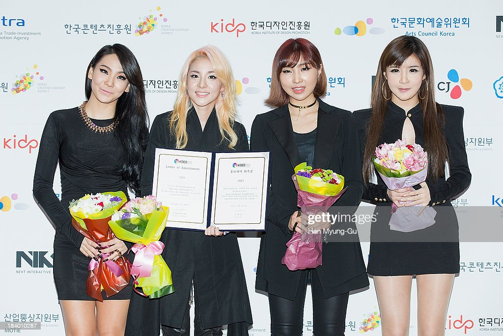 Lee Chae-Rin (CL), Dara, Minzy and Bom of South Korean girl group 2NE1 attend the press conference to announce the 2NE1 being appointed as honorary ambassador for 2013 KBEE (Korea Brand and Entertainment Expo) in London at Kotra on October 10, 2013 in Seoul, South Korea.