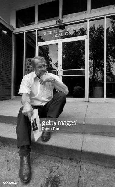 Lee Chisholm sits outside the headquarters of United Rubber Workers Local at 55 W Nevada Place He is the President of the Union He is holding the...