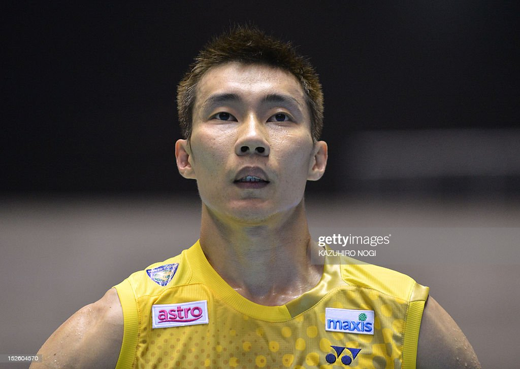 Lee Chong Wei of Malaysia attends the men's singles final against Boonsak Ponsana of Thailand at the Japan Open badminton tournament in Tokyo on September 23, 2012. Lee Chong Wei won the match 21-18, 21-18. AFP PHOTO / KAZUHIRO NOGI