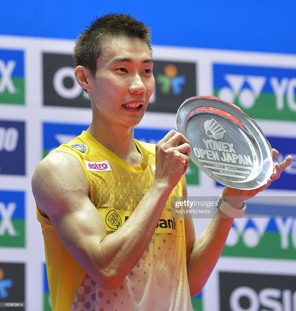 Lee Chong Wei of Malaysia celebrates his win during the award ceremony of the men's singles final against Boonsak Ponsana of Thailand at the Japan Open badminton tournament in Tokyo on September 23, 2012. Lee Chong Wei won the match 21-18, 21-18.
