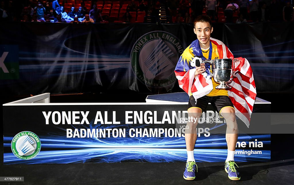 Lee Chong Wei of Malaysia celebrates with his trophy after beating Chen Long of China in their All England Open Badminton Championships men's singles final match on March 9, 2014, in Birmingham, England.