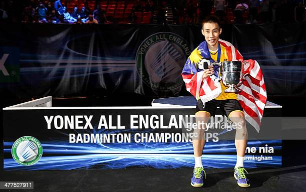 Lee Chong Wei of Malaysia celebrates with his trophy after beating Chen Long of China in their All England Open Badminton Championships men's singles...