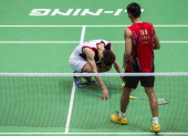 Lee Chong Wei of Malaysia crouches on the court injured during the men's singles final match against Lin Dan of China during the Badminton World...