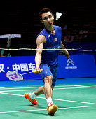 Lee Chong Wei of Malaysia hits a return against Chen Long of China during their men's singles final match at the 2016 Badminton Asia Championships in...