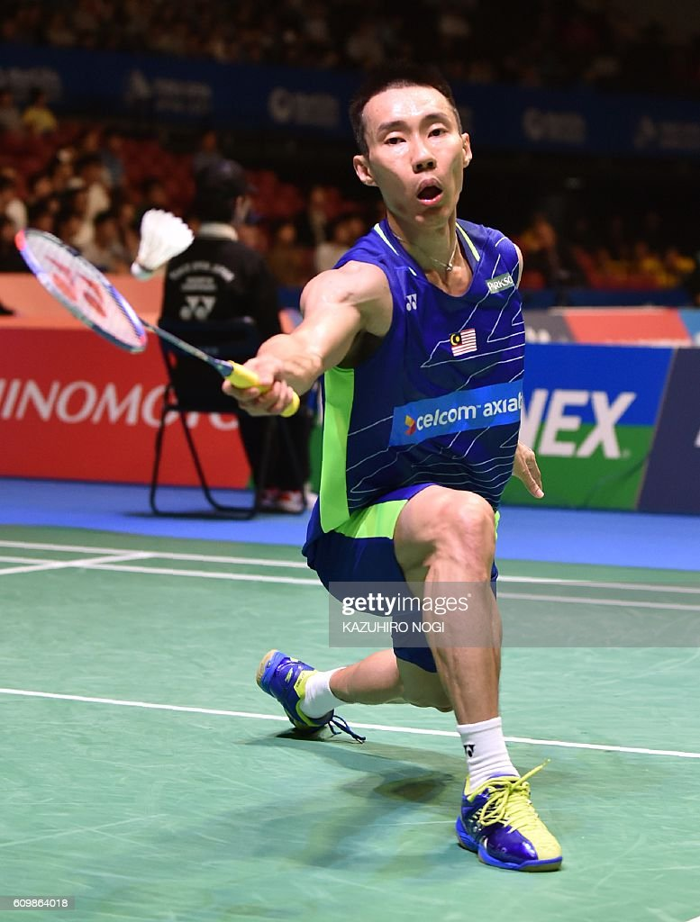 Lee Chong Wei of Malaysia hits a return against China s Shi Yuqi