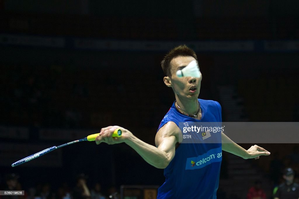 Lee Chong Wei of Malaysia hits a return against Chou Tien Chen of Taipei during their men's singles quarter-final match at the 2016 Badminton Asia Championships in Wuhan, central China's Hubei province on April 29, 2016. / AFP / STR