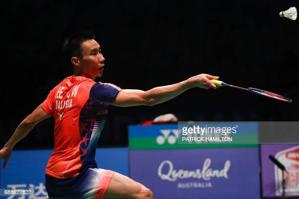 Lee Chong Wei of Malaysia hits a return against Japan's Kenta Nishimoto during their men's singles Sudirman Cup badminton match at the Gold Coast...