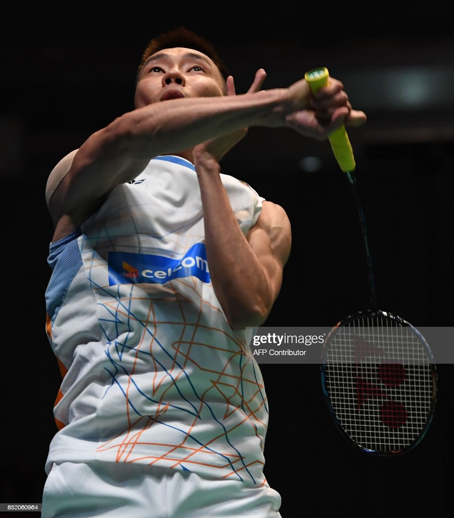 Lee Chong Wei of Malaysia hits a return towards Shi Yuqi of China