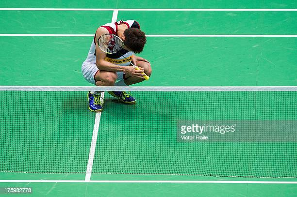 Lee Chong Wei of Malaysia pauses on the court injured during the men's singles final match against Lin Dan of China during the Badminton World...