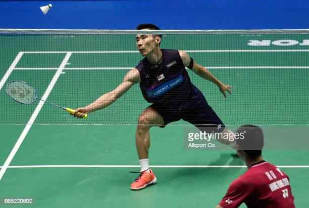 Lee Chong Wei of Malaysia plays a return shot to Hu Yun of Hong Kong in the men's singles during round two of the 2017 World BWF Super Series...
