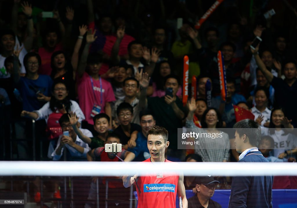 Lee Chong Wei of Malaysia pose for pictures after him winning men's singles semi-final match against Lin Dan of china at the 2016 Badminton Asia Championships, in Wuhan, Hubei province, China, April 30, 2016.