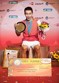 Lee Chong Wei of Malaysia poses with the trophy on the podium after winning the men singles final match against Sony Dwi Kuncoro of Indonesia during...