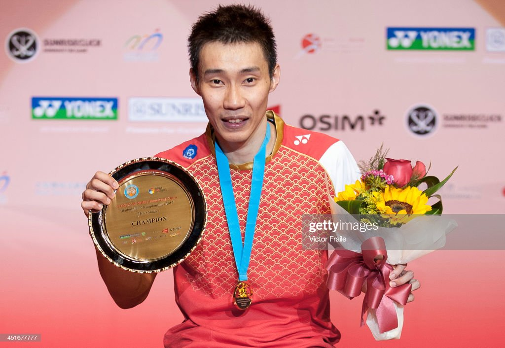 Lee Chong Wei of Malaysia poses with the trophy on the podium after winning the men singles final match against Sony Dwi Kuncoro of Indonesia during the Yonex-Sunrise Hong Kong Open Badminton Championship 2013 on November 24, 2013 in Hong Kong, Hong Kong.