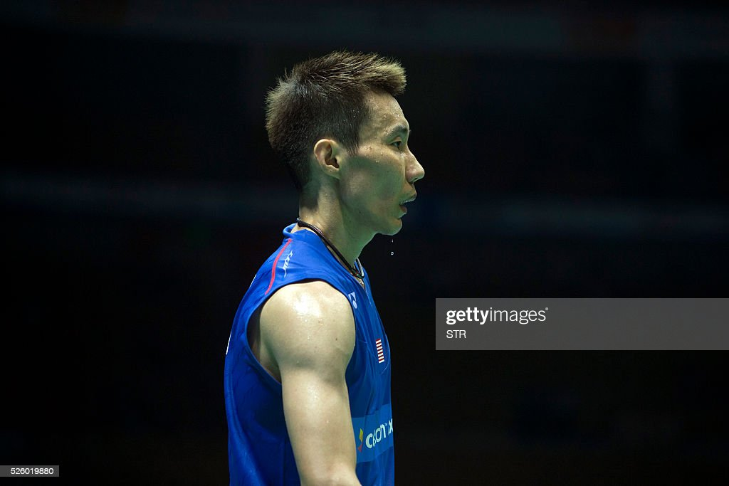 Lee Chong Wei of Malaysia reacts during the men's singles quarter-final match against Chou Tien Chen of Taipei at the 2016 Badminton Asia Championships in Wuhan, central China's Hubei province on April 29, 2016. / AFP / STR