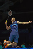 Lee Chong Wei of Malaysia returns to Takuma Ueda of Japan in the Men Singles during round one of the BWF World Super Series Badminton Malaysia Open...