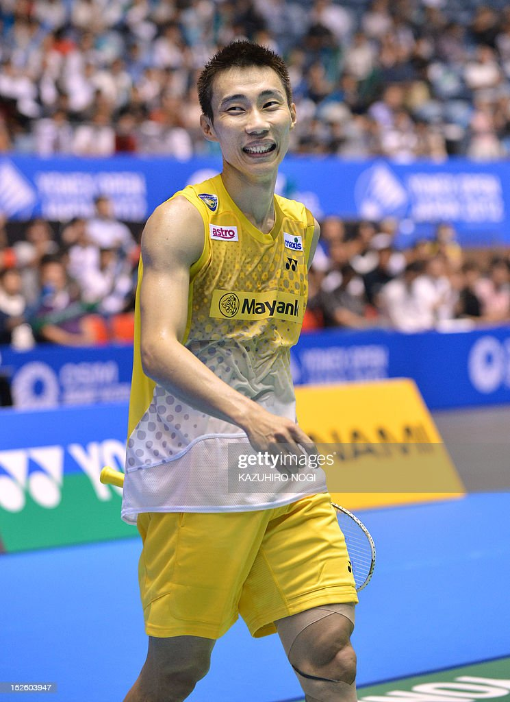 Lee Chong Wei of Malaysia smiles as he celebrates his win over Boonsak Ponsana of Thailand during the men's singles final at the Japan Open badminton tournament in Tokyo on September 23, 2012. Lee Chong Wei won the match 21-18, 21-18. AFP PHOTO / KAZUHIRO NOGI