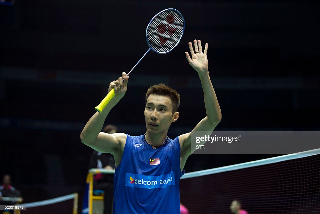 Lee Chong Wei of Malaysia waves to the audience after winning the men's singles quarter-final match against Chou Tien Chen of Taipei at the 2016 Badminton Asia Championships in Wuhan, central China's Hubei province on April 29, 2016. / AFP / STR
