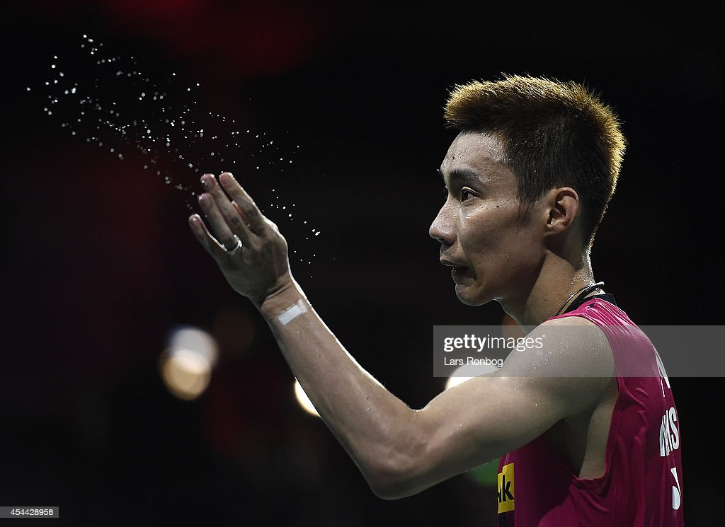 <a gi-track='captionPersonalityLinkClicked' href=/galleries/search?phrase=Lee+Chong+Wei&family=editorial&specificpeople=647820 ng-click='$event.stopPropagation()'>Lee Chong Wei</a> of Malaysia wipes sweat from his face in the mens single against Chen Long of China in the finals during the Li-Ning BWF World Badminton Championships at Ballerup Super Arena on August 31, 2014 in Copenhagen, Denmark.