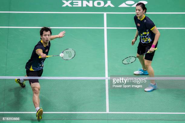 Lee Chun Hei Reginald and Chau Hoi Wah of Hong Kong in action against Kim Won Ho and Shin Seung Chan of South Korea during their mixed doubles...