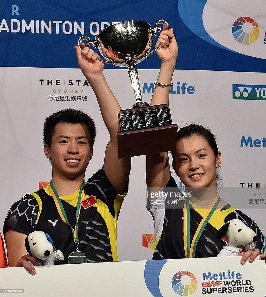 Lee Chun Hei Reginald L and Chau Hoi Wah of Hong Kong lift their