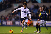 Lee ChungYong of Bolton and Alan Dunne of Millwall FC in action during the Sky Bet Championship match between Millwall and Bolton Wanderers at The...