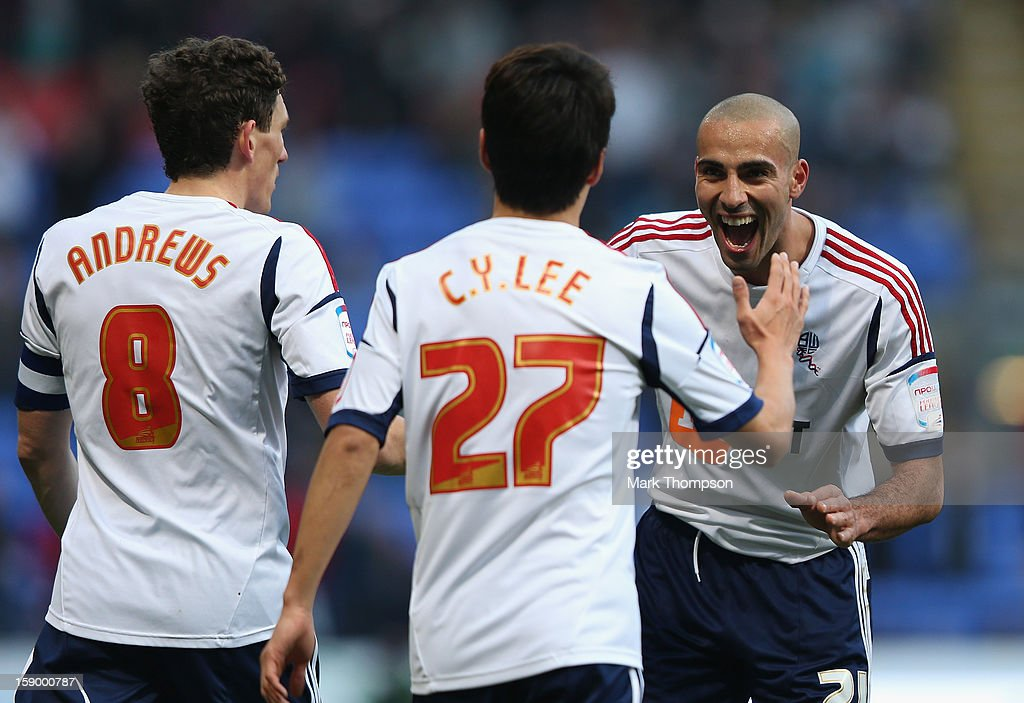 <a gi-track='captionPersonalityLinkClicked' href=/galleries/search?phrase=Lee+Chung-Yong&family=editorial&specificpeople=4379867 ng-click='$event.stopPropagation()'>Lee Chung-Yong</a> of Bolton Wanderers celebrates scoring the opening goal with team-mate Darren Pratley of Bolton Wanderers (r) during the FA Cup with Budweiser Third Round match between Bolton Wanderers and Sunderland at the Reebok Stadium on January 5, 2013 in Bolton, England.