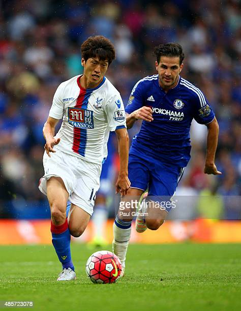 Lee Chungyong of Crystal Palace and Cesc Fabregas of Chelsea compete for the ball during the Barclays Premier League match between Chelsea and...