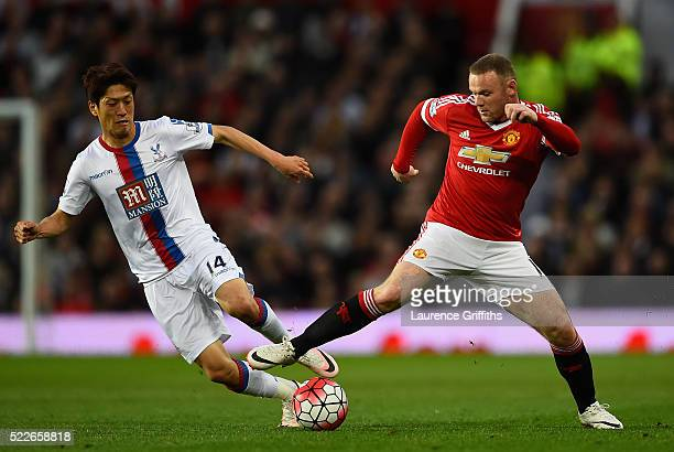 Lee Chungyong of Crystal Palace makes a challenge on Wayne Rooney of Manchester United during the Barclays Premier League match between Manchester...