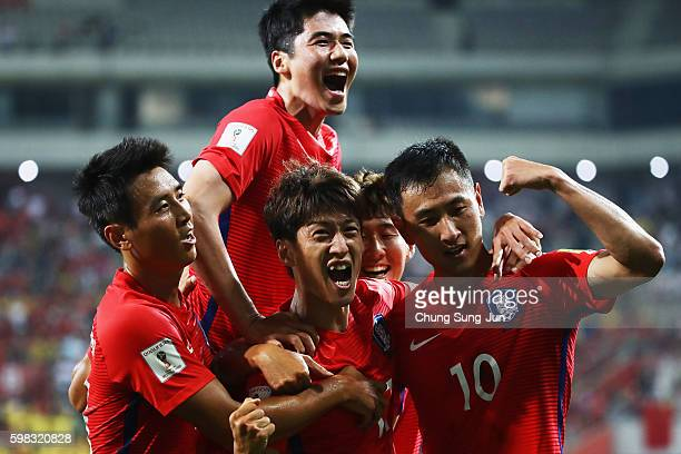 Lee Chungyong of South Korea celebrates scoring his team's second goal with his team mates during the 2018 FIFA World Cup Qualifier Final Round Group...