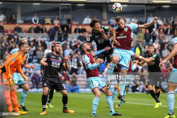Lee ChungYoung of Crystal Palace and Chris Wood of Burnley during the Premier League match between Burnley and Crystal Palace at Turf Moor on...