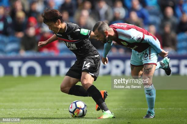 Lee ChungYoung of Crystal Palace and Steven Defour of Burnley during the Premier League match between Burnley and Crystal Palace at Turf Moor on...