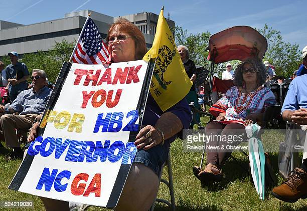 Lee Churchill shows her support of HB2 during a rally on Halifax Mall behind the North Carolina General Assembly building in Raleigh NC on Monday...