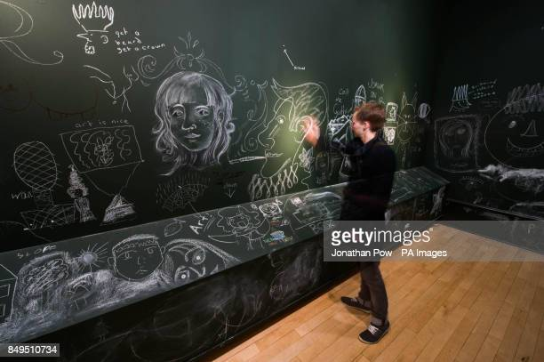 PHOTO Lee Clark draws at York Art Gallery which has opened its doors and walls for visitors to graffiti