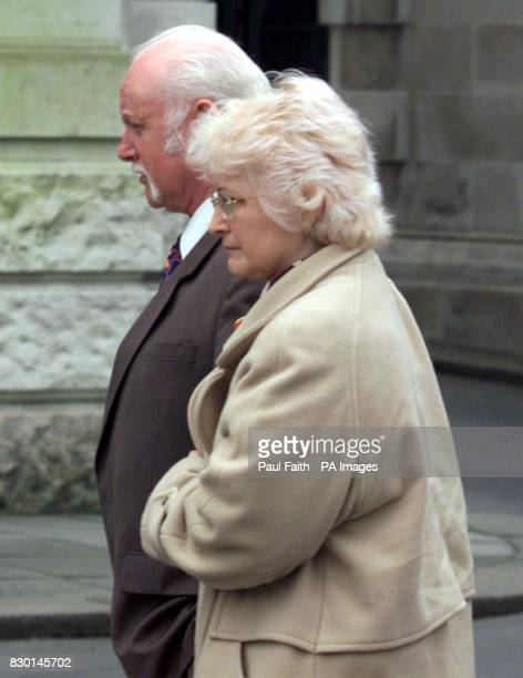 Lee Clegg's stepfather Mr Roberts and mother Wynne Johnston arrive at Belfast High Court where they heard that Lee had been acquitted of the 1990...
