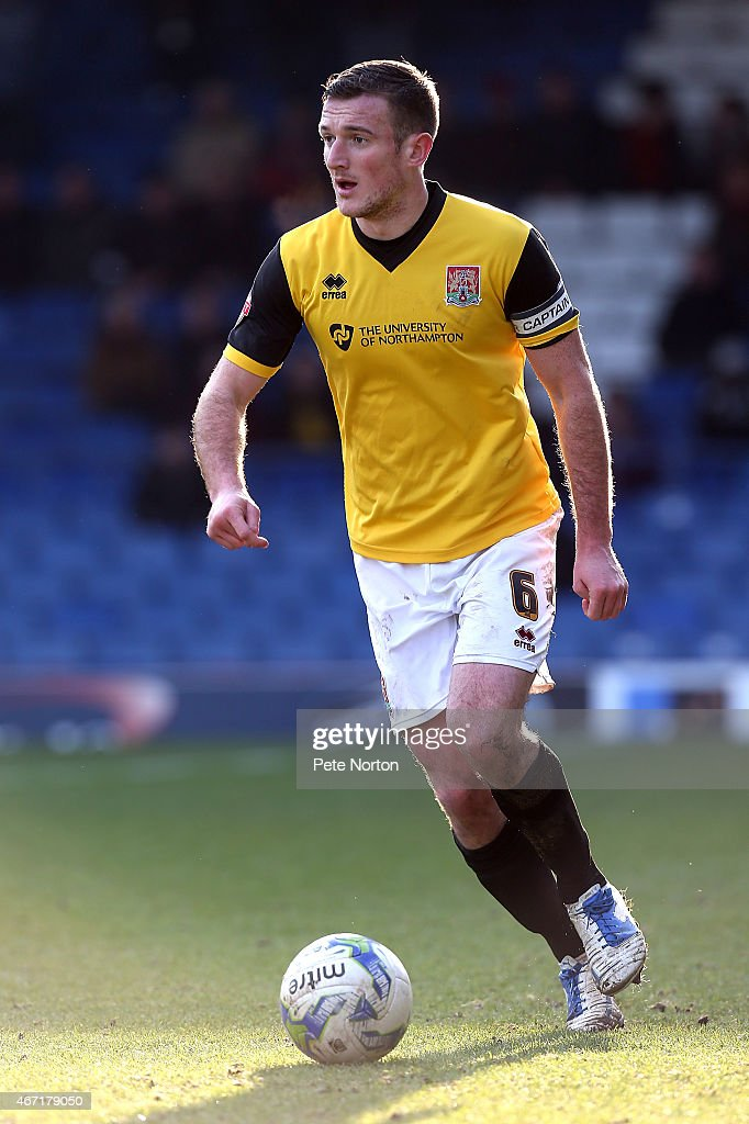 Lee Collins of Northampton Town in action during the Sky Bet League Two match between Bury and Northampton Town at The JD Stadium on March 21 2015 in...