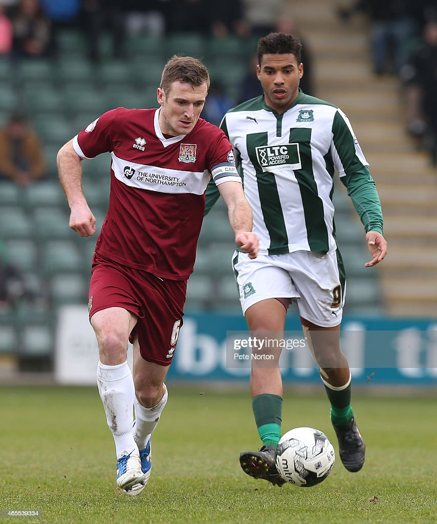 Lee Collins Of Northampton Town Moves Forward With The Ball Away From Reuben Reid Plymouth